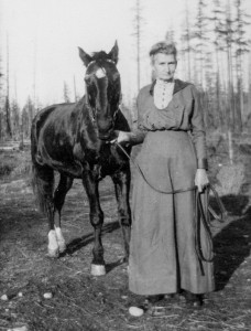 1914 ca Ida Mae Street with her horse Nigger  at Coupeville, WA