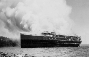1937 ca  Ship burning for salvage in cove