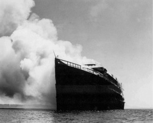 1937 ca - Ship burning for salvage in cove