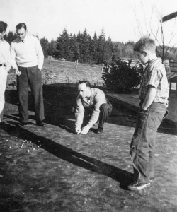 1942-03 Donald Wasson, Dick Wasson, Rollin Hansen, and Robert Hansen playing marbles in Rollins yard