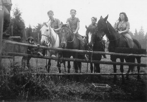 1942-09 Roald on Spook, David Schwab on Smoly, Robert on Billy, Merna on Firefly  - just inside pasture looking west toward the garden