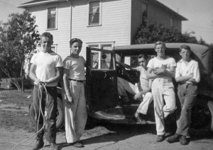 1944-11 Roald, Dave Schwab, Bill Broberg, Norm, Don standing by Bill's 1931 Model A Ford Victoria