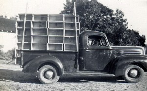 1945-09 Zucchini rack on Rollins pickup truck. My brother Bob is sitting in the truck.