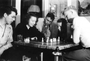1946-04 Don Hansen, Mary Lou Dunn, Ted Matzek, Bob Hansen, and Norm Hansen in the big house playing chess