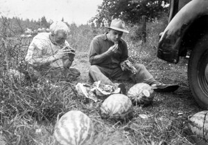 1948-08  Norm and Rollin Hansen eating left-over watermelon from the Fruit Stand