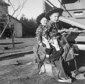 1948-12-27 Mark and Greg Thomsen playing cowboys