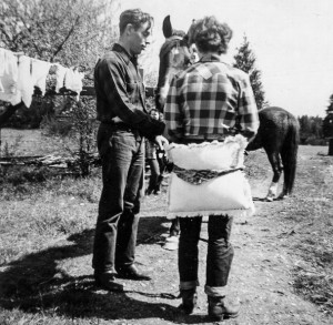 1949 Roald (Dusty) Hansen preparing to teach his financee  Jean Waye horseback riding