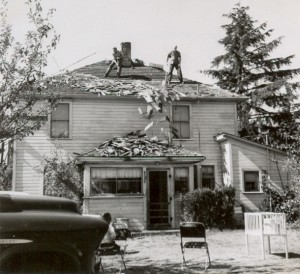1957-09-22 Re-roofing the big house. Bill Bailey and Norm Hansen are on roof