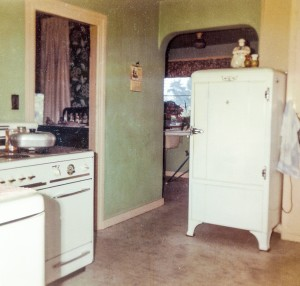 1965-10 kitchen from near back porch toward dining room - note 1934 Frigidaire