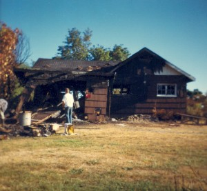 1966-08 Don and Dave Schwab standing by the little house, cleaning up after the fire